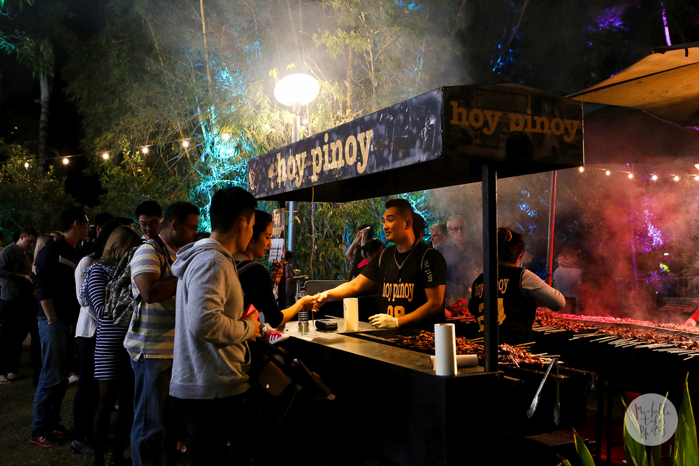 Thousands of people enjoy the food on offer at the Night Noodle Markets including the popular skewers at Hoy Pinoy.