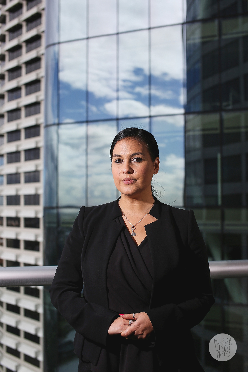 Indigenous Lawyer for Allens Linklaters, Jayde Geia, 28, poses for a photograph other office on Eagle Street.