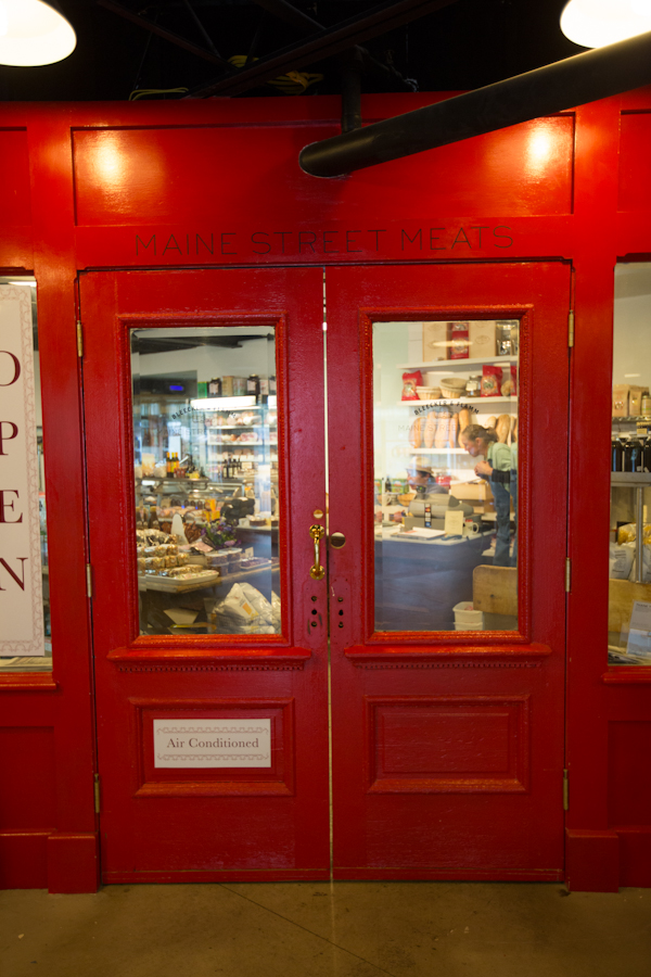 Look for our red doors inside The Rockport Market Place, State of Maine Cheese Building.