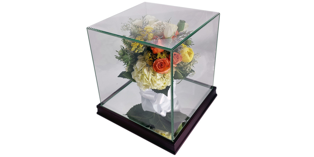 "Freeze dried flower bouquet preserved in a 10"" x 10"" square glass case with walnut frame"