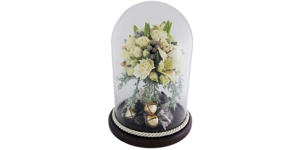 "Freeze dried flowers from a bridal bouquet preserved in a 8"" x 12"" glass dome with walnut base"
