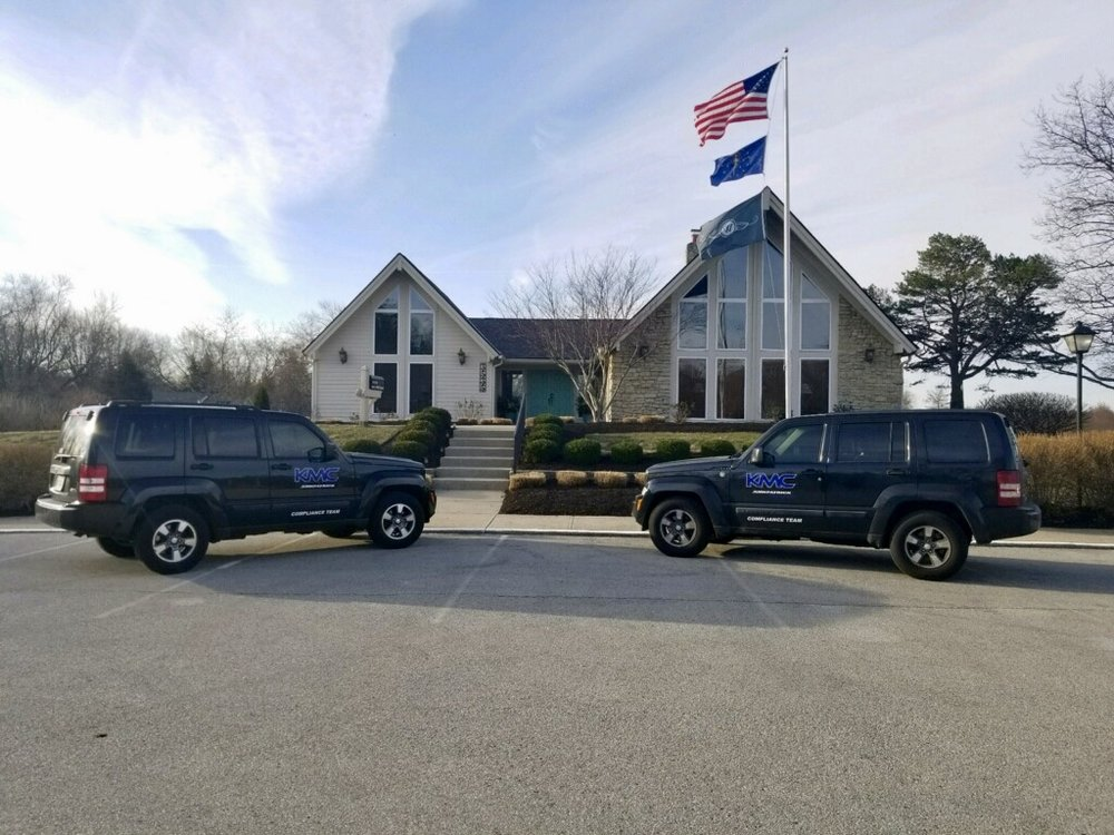 Kirkpatrick Management Company compliance team vehicles.