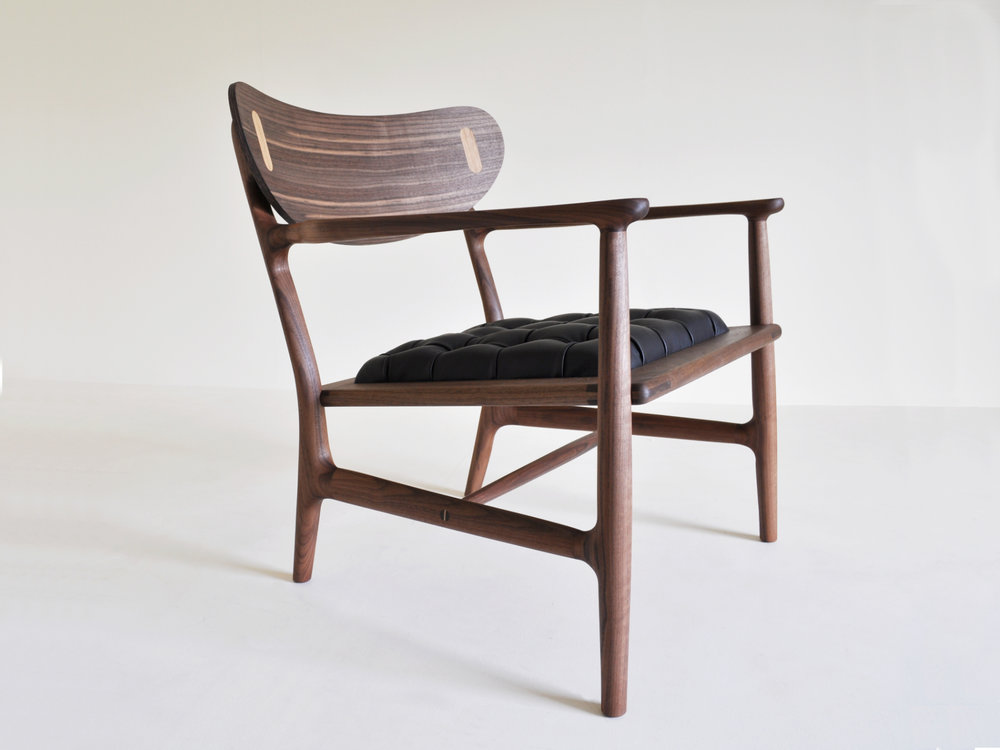 Alberto Perez' 'La Negra' Walnut and leather chair. This chair was one of the pieces that received a majority of votes for the 'People's Choice' award at the 2017 Somerset Guild of Craftsmen Furniture Prize. This was Alberto's first design project on course and really challenged and pushed his making skills.