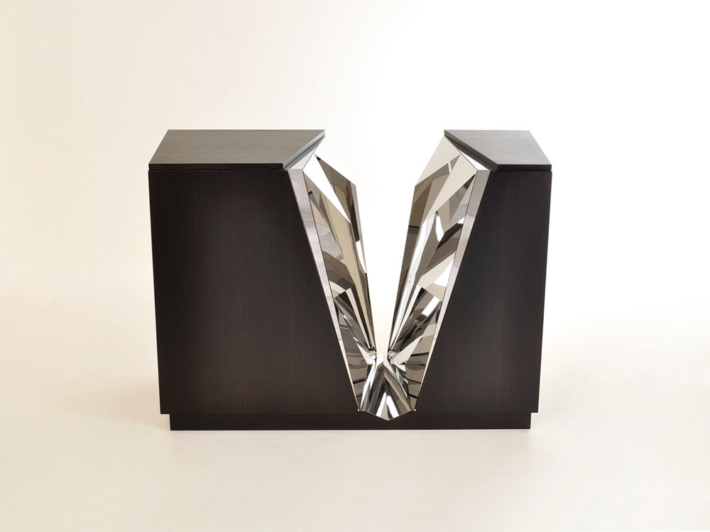 Jessica Fairley's 'Glacier' cabinet made in Fumed Oak veneer with individually cut mirrored steel facets. The cabinet was inspired by Jessica's love of the mountains.