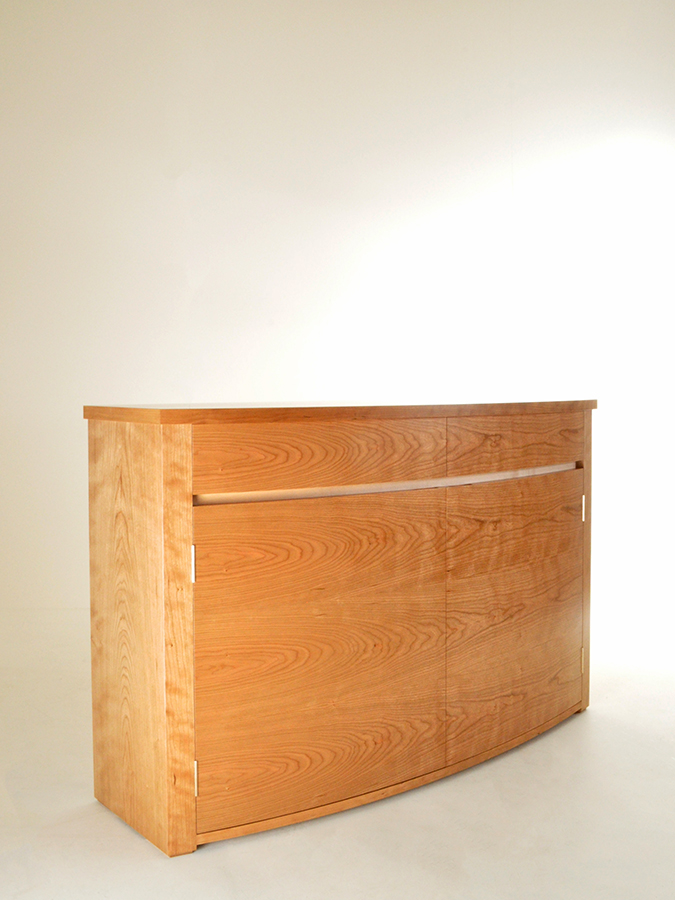 Ken Olgilvie's Cherry bow fronted cabinet.