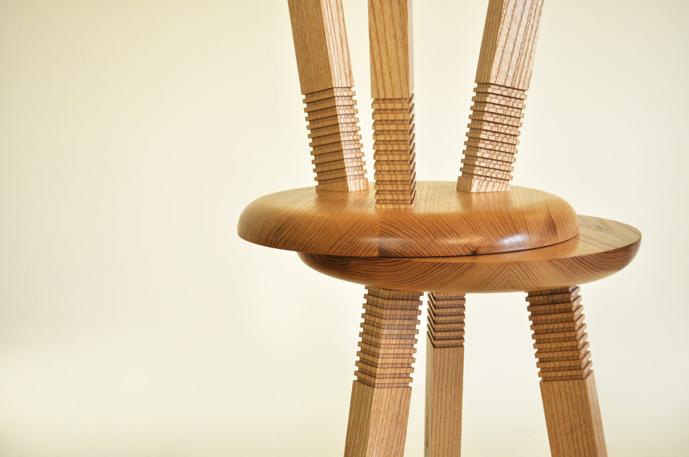 Wilma Wyatt's Ash stools with coloured resin copper sections on the seat, and routed detailing on the legs.