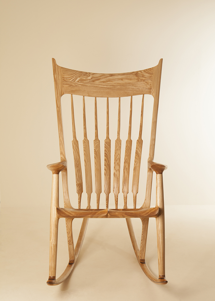 Henry Baltesz'  Sam Maloof inspired rocking chair made in Olive Ash with Walnut detail on the rails. This chair has been meticulously shaped for design and comfort.