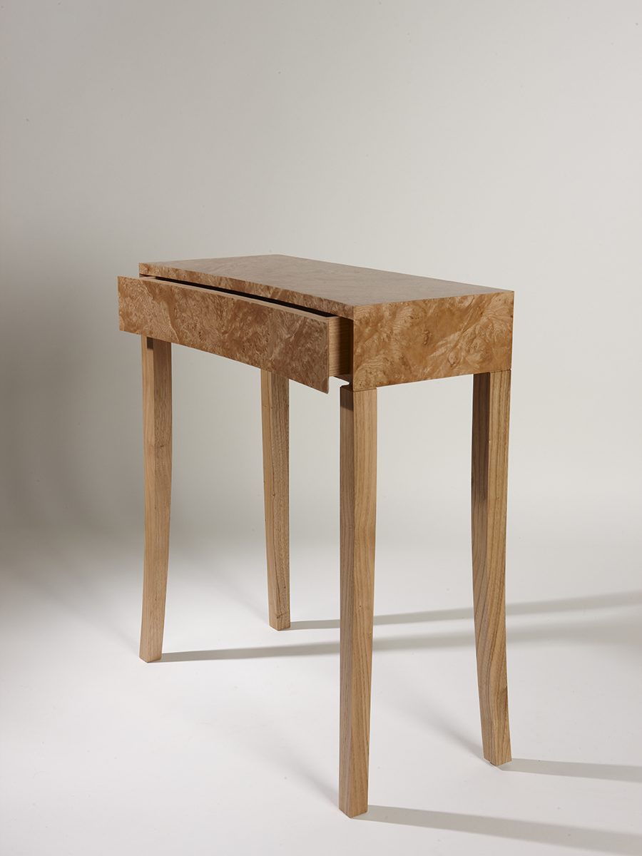 Helen Lawson's Burr Chestnut side table with curved fronted drawer and book matched veneer.