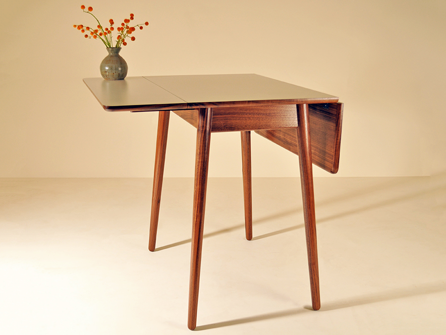 Laura Aldrich Blake's drop leaf table in Walnut and Formica. The brief for this project was all about batch production and made using various jigs so it could be easily repeated in small numbers.