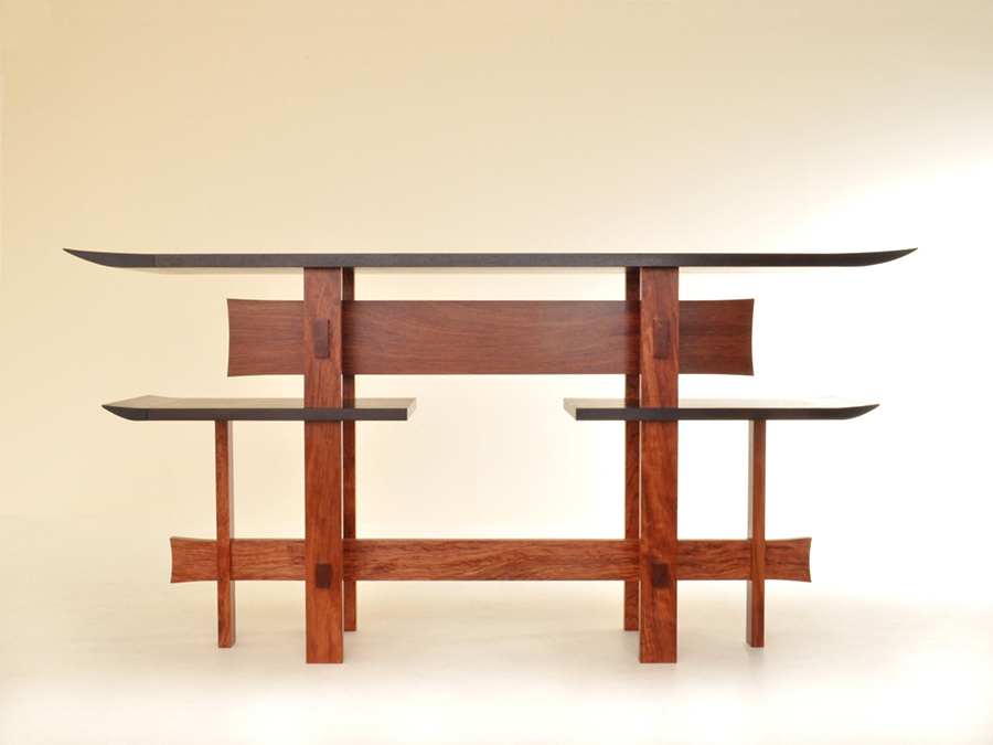 Ali Buchan's console table inspired by the famous floating Torii Gate at the Itsukushima Shrine in Hiroshima, Japan. Made in African wenge, with the rails and legs made from African bubinga.