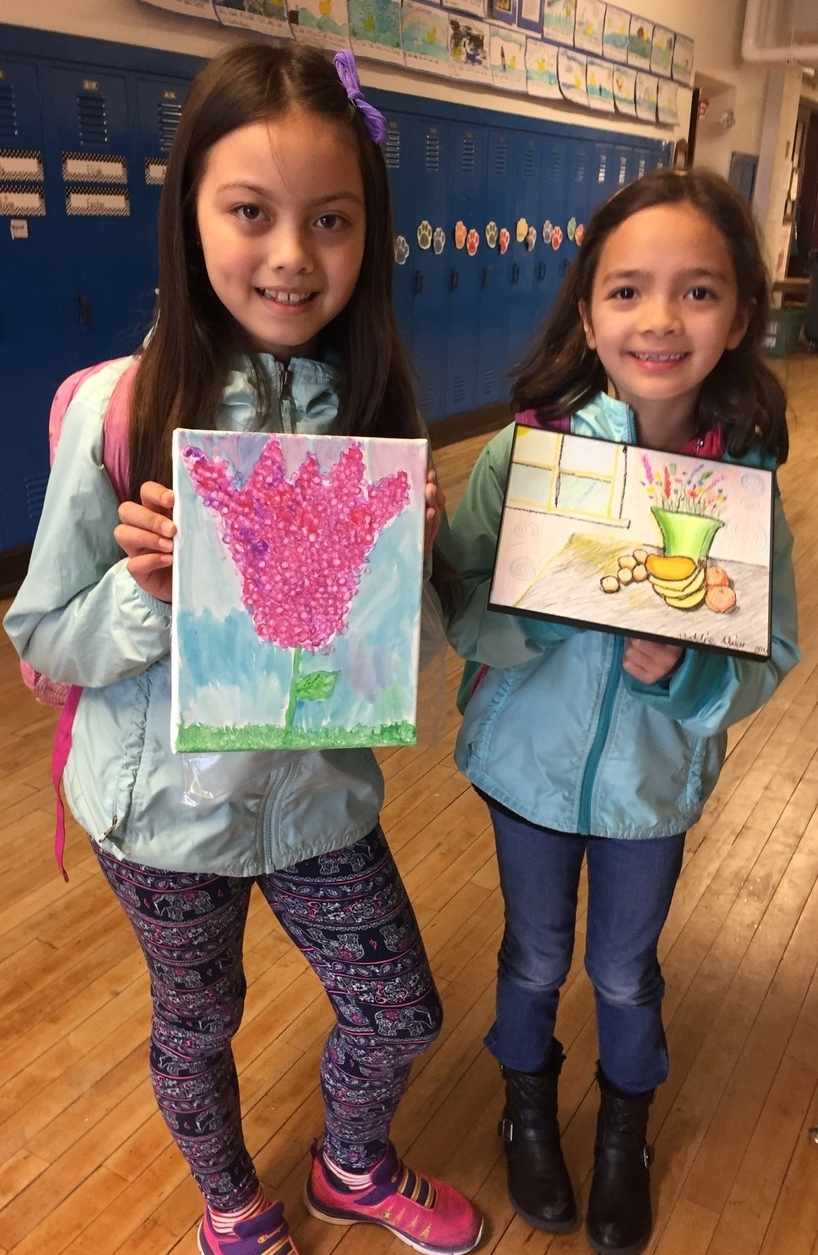 Fellow second graders, Maya Veitengruber and Madeline Alviar, at McGilvra Elementary School show off their completed artwork.