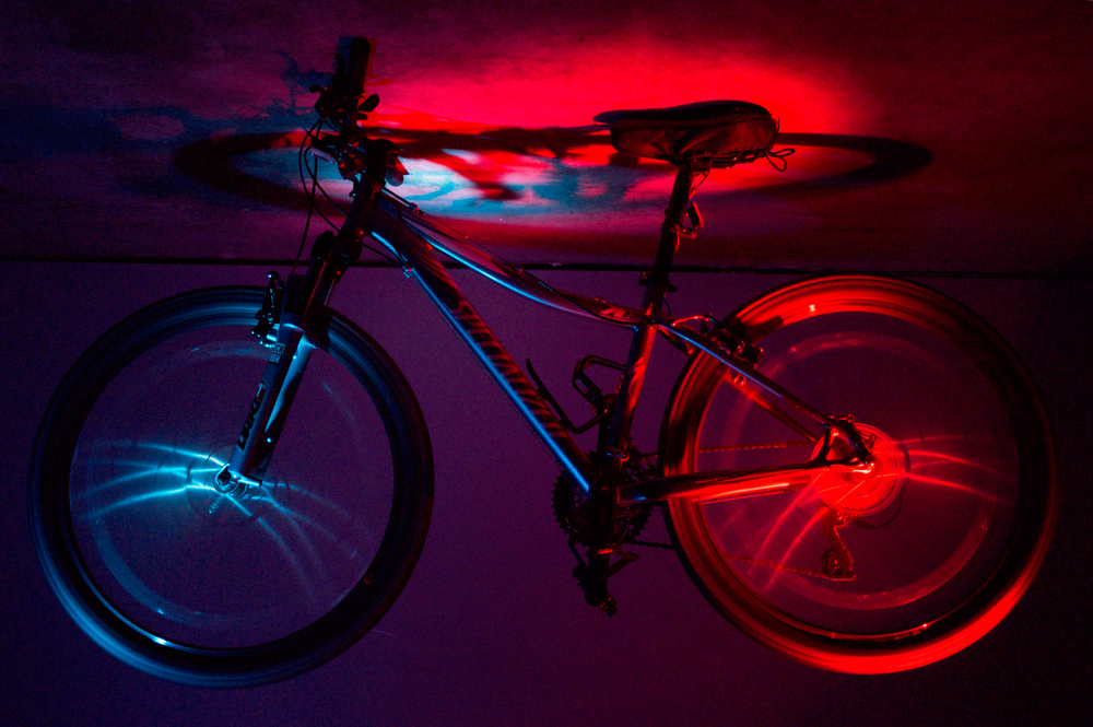 Flying Bike    Nikon D3200 • Nikon 18-55mm lens • 32mm • F/18 • 25s • ISO 400 • Plus a Splash of Colored Light