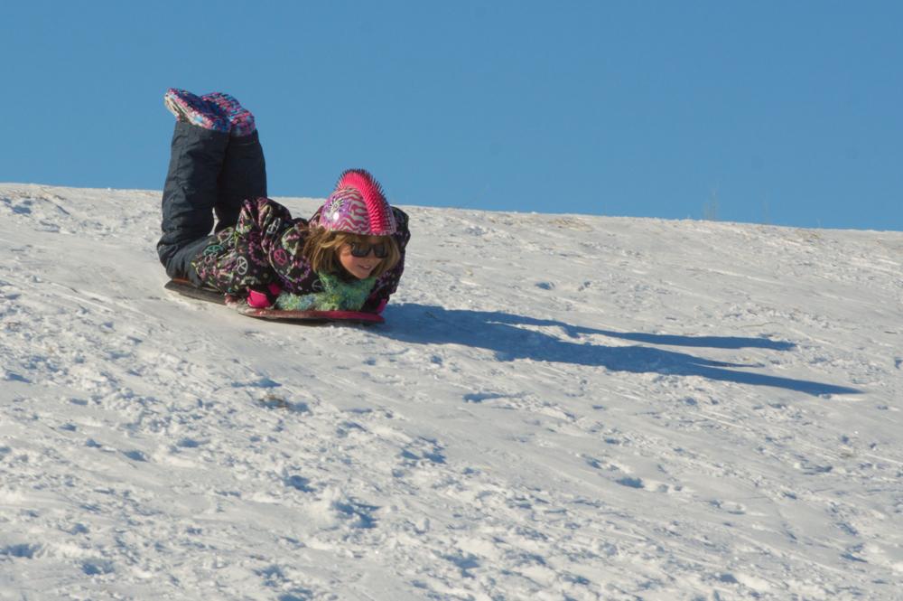 Winter Sledding Fun!    Nikon D3200 • Nikon 55-200mm lens • 100mm • F/18 • 1/320s • ISO 200