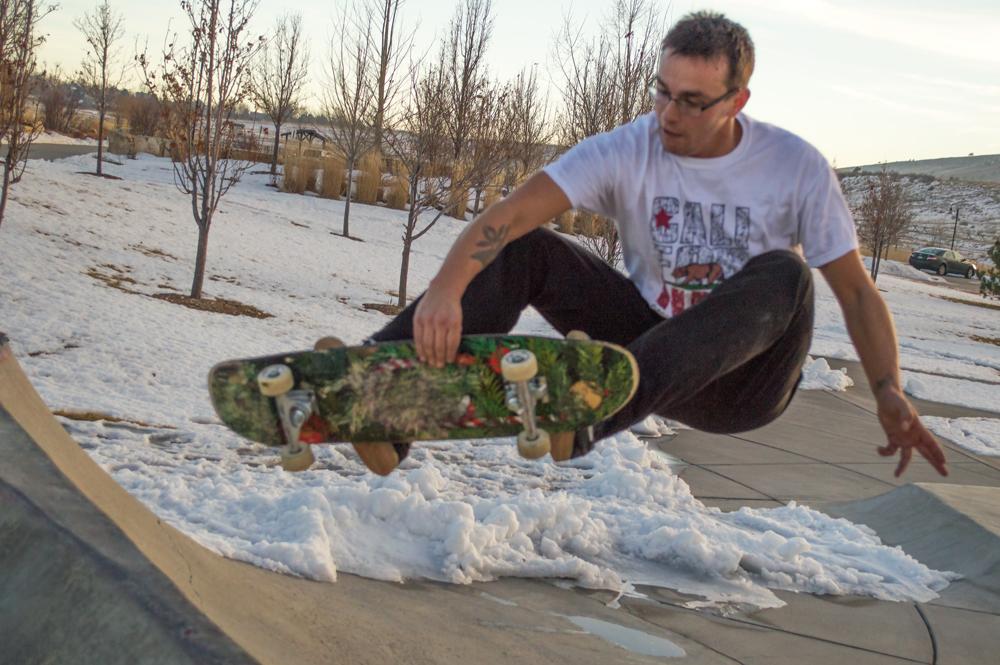 Skater Getting His Fix    Nikon D3200 • Nikon 18-55mm lens • 38mm • F/5.6 • 1/2000s • ISO 800