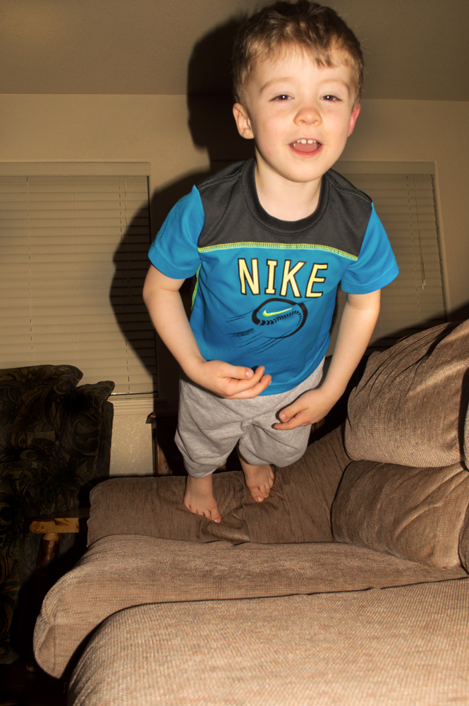 Desmond Launching Himself onto the Couch    Nikon D3200 • Nikon 18-55mm lens • 26mm • F/8 • 1/60s • ISO 200 (Auto Flash)
