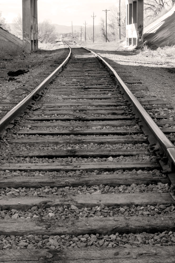 Rail Road Tracks Looking West    Nikon D3200 • Nikon 18-55mm lens • 48mm • F/25 • 1/25s • ISO 400
