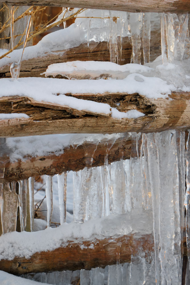 Icicles Draped on a Wooden Fence    Fujifilm X-E2 • Fuji XF18-135mm lens • 66.2mm • F/6.4 • 1/180s • ISO 500