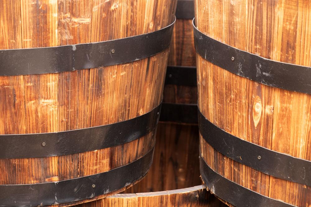 Whiskey Barrel Planters    Fujifilm X-E2 • Fuji XF18-135mm lens • 49.4mm • F/5 • 1/45s • ISO 640