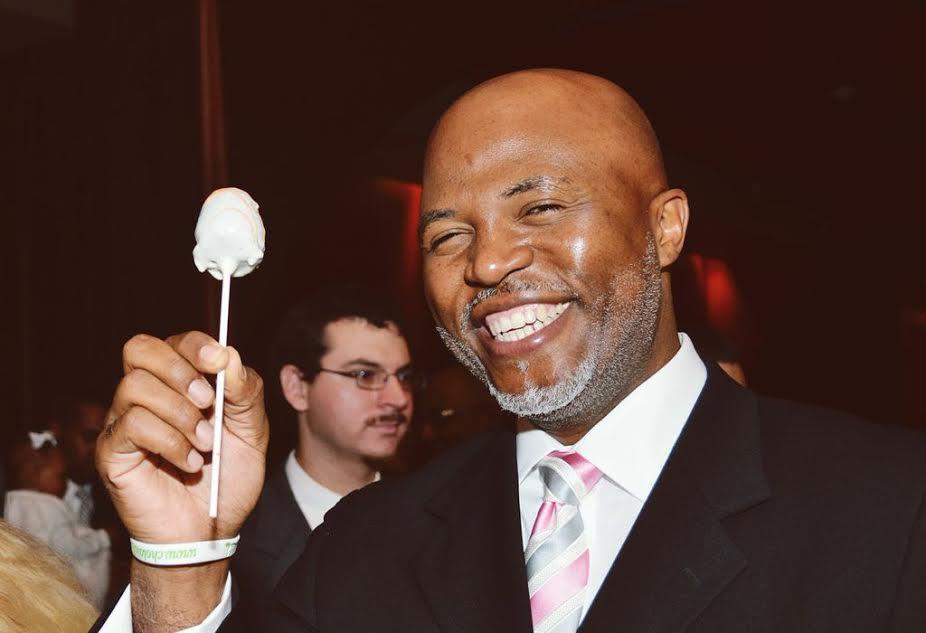 Dr. Dorrien enjoying a cake pop at a wedding.