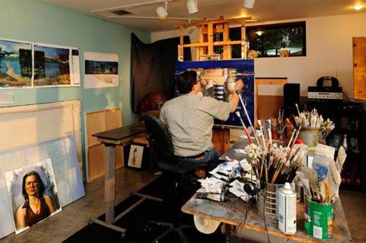 Faigin painting in his home studio.