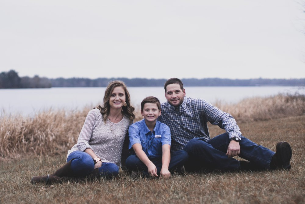 Deacon Brandon Lily with his wife Sara and their son -