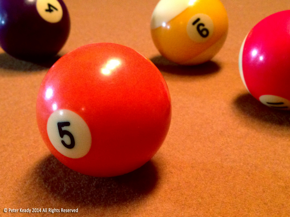 Billiard balls can be used to demonstrate Newton's First Law of Motion, or Law of Inertia. They can also be used to motivate people, but that's not recommended.