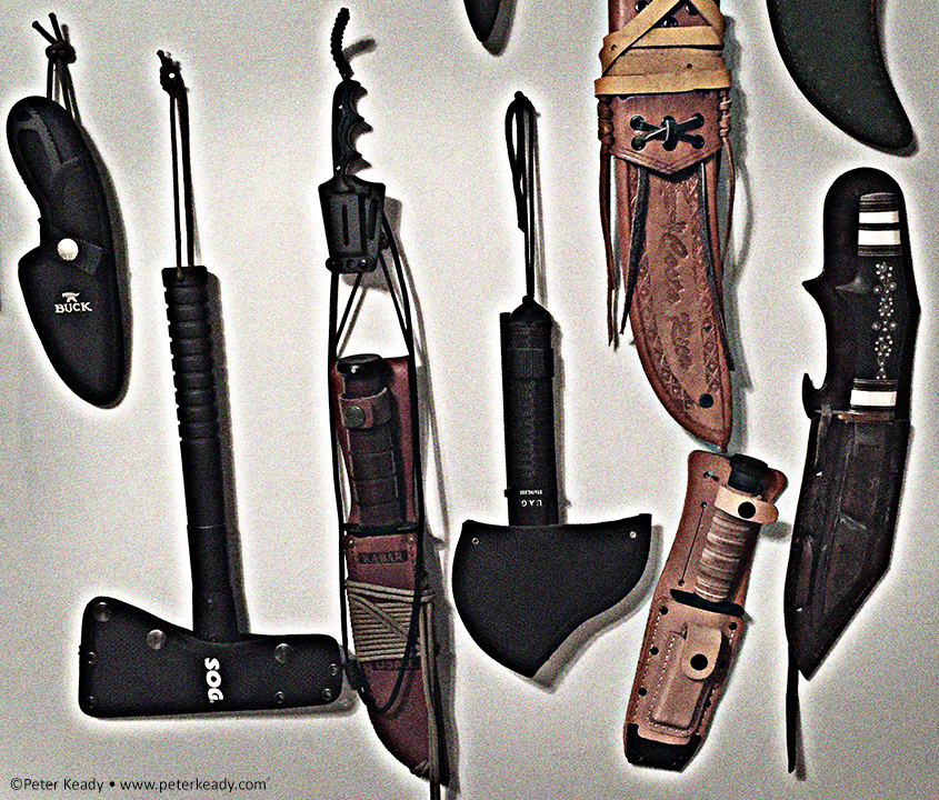 Knives. A section of my collection that hangs above my work desk. I like knives. I have a few from around the world. They tell stories. They're tools. Unless handled by a dark heart.