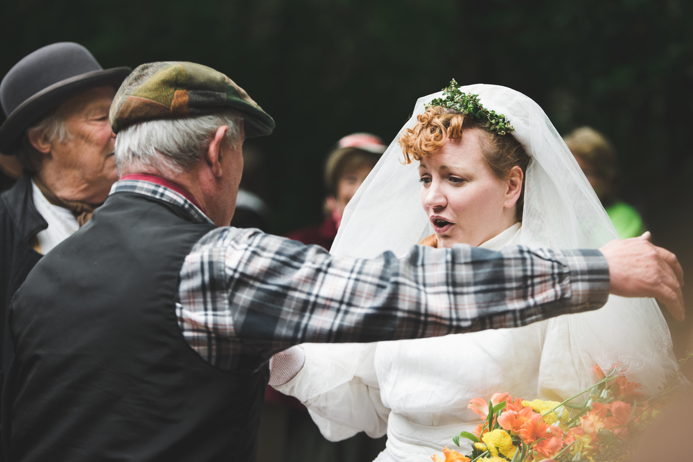 The local Blacksmith greets the Bride
