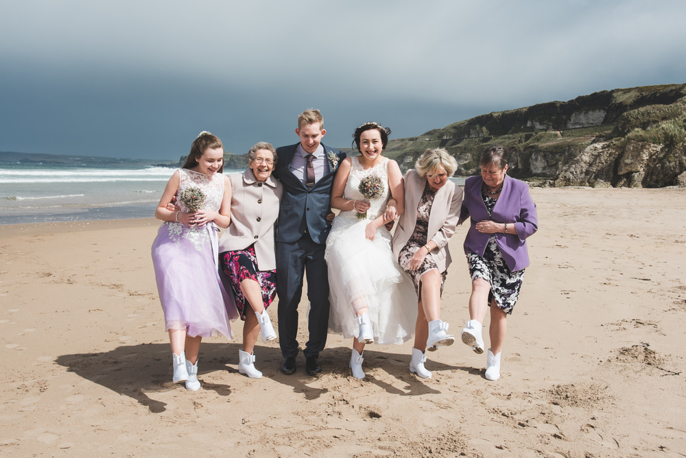Northern_Ireland_Wedding_Photographer_Pure_Photo_NI_Shauna_Lewis_White_Rocks_Beach_kicking