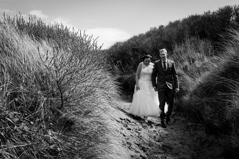 Northern_Ireland_Wedding_Photographer_Pure_Photo_NI_Shauna_Lewis_White_Rocks_Beach_Family_Groom_Bride_Walking