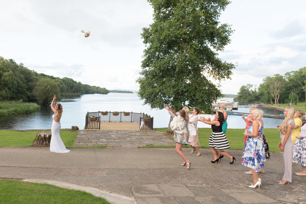 Lusty Beg Island Northern Ireland Wedding Photographers Pure Photo N.I bride throwing boquet
