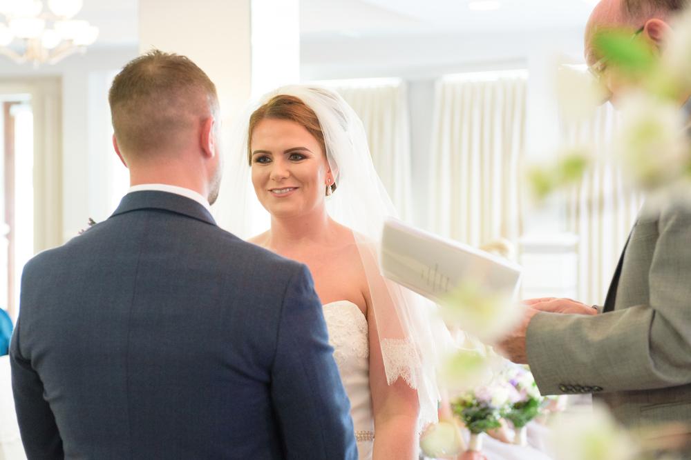Belfast Wedding Photographer purephotoni Ramada Plaza ceremony bride and groom