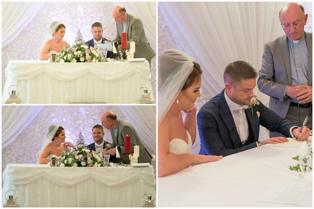 Belfast Wedding Photographer purephotoni Ramada Plaza ceremony bride and groom sign