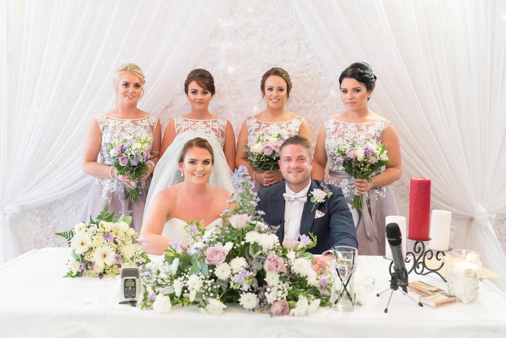 Belfast Wedding Photographer purephotoni Ramada Plaza ceremony bride and groom signing