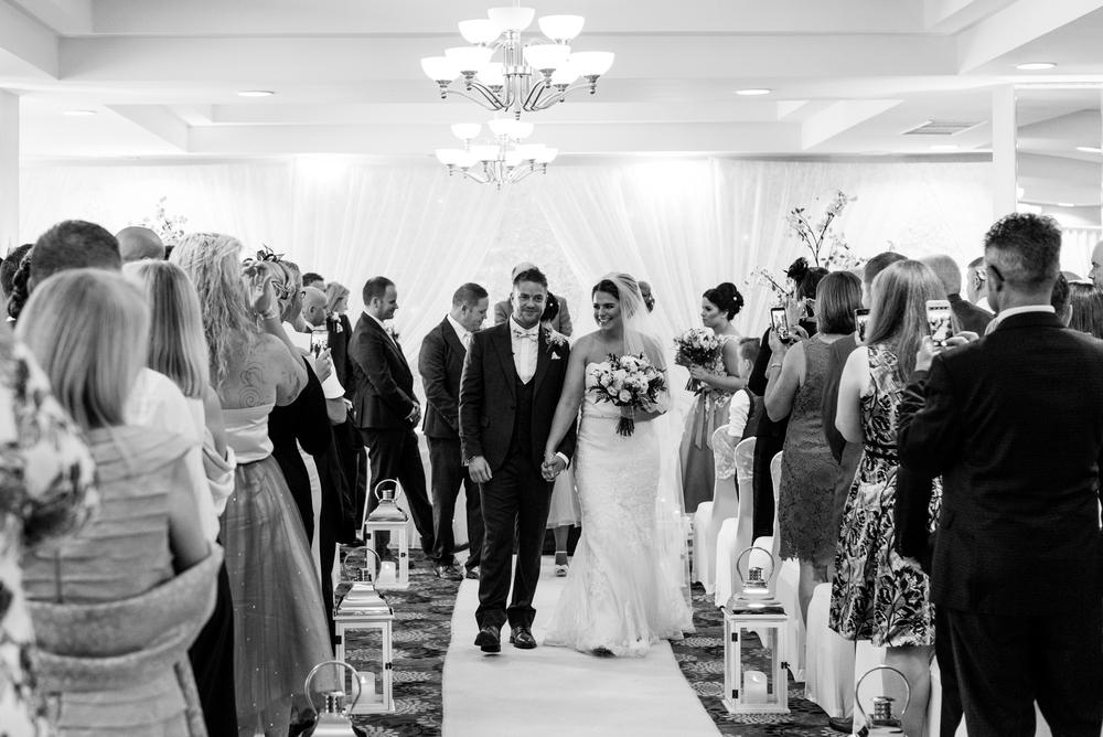 Belfast Wedding Photographer purephotoni Ramada Plaza ceremony bride and groom reccisional