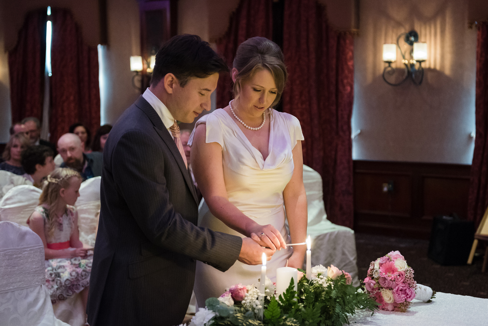 Canal Court Hotel Newry Wedding photographer Pure Photo N.I ceremony bride groom candle