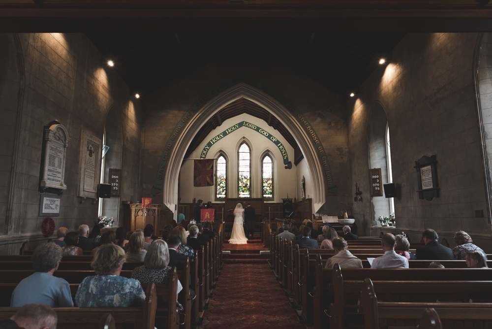 Lisburn Wedding Photographer Pure Photo N.I Magheragall Parish Church ceremony bride groom back