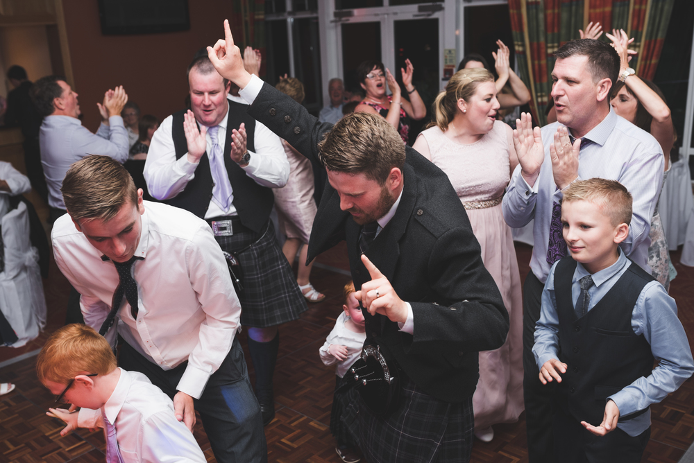 Lisburn Wedding Photographer Pure Photo N.I Edenmore Country Club groom dancing
