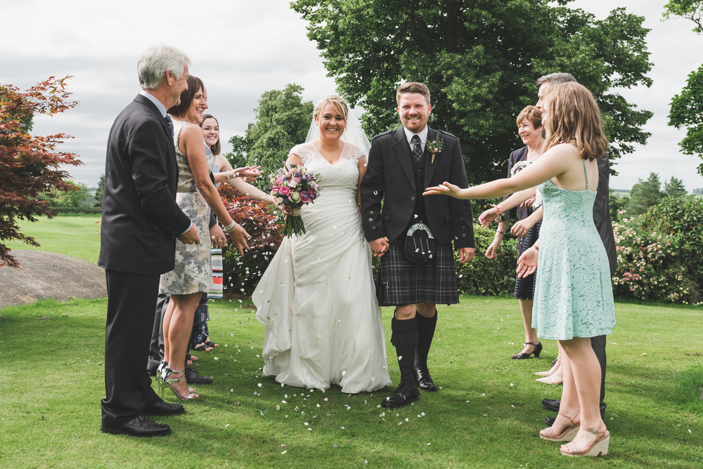 Lisburn Wedding Photographer Pure Photo N.I Edenmore Country Club bride and groom confetti