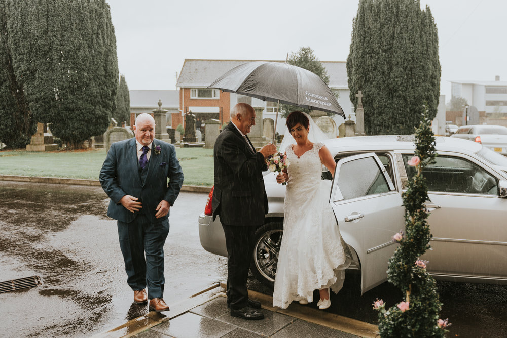 Christ Church Limavady wedding photographer Pure Photo N.I brides arrival rain