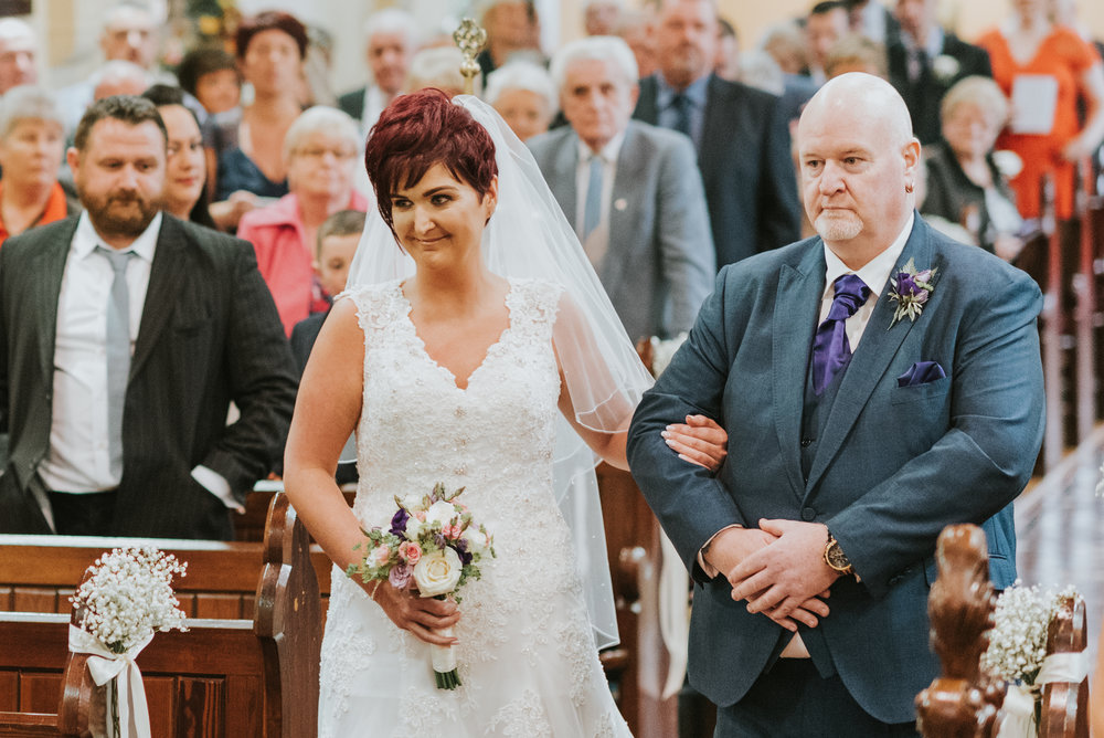 Christ Church Limavady wedding photographer Pure Photo N.I bride aisle