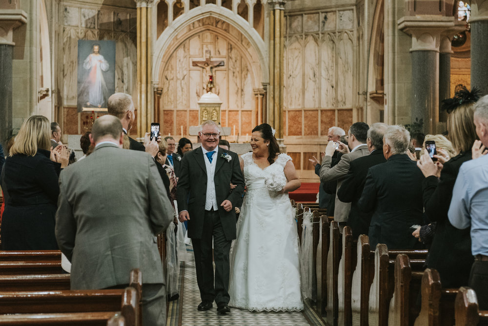 St. Pauls belfast wedding photographer pure photo n.i aisle