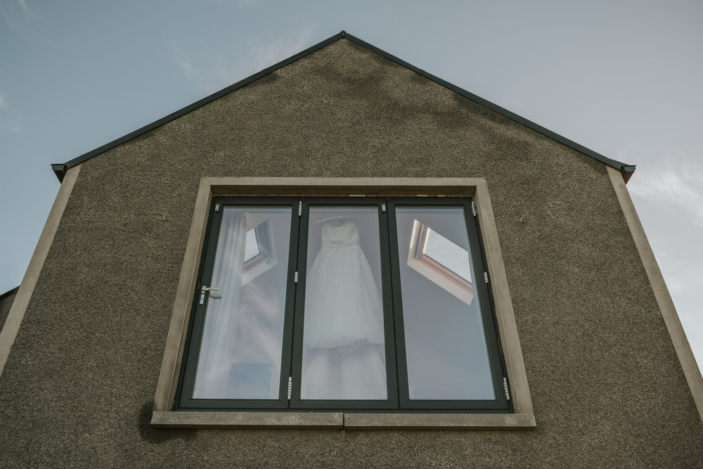 Tullyglass House Hotel wedding dress in window
