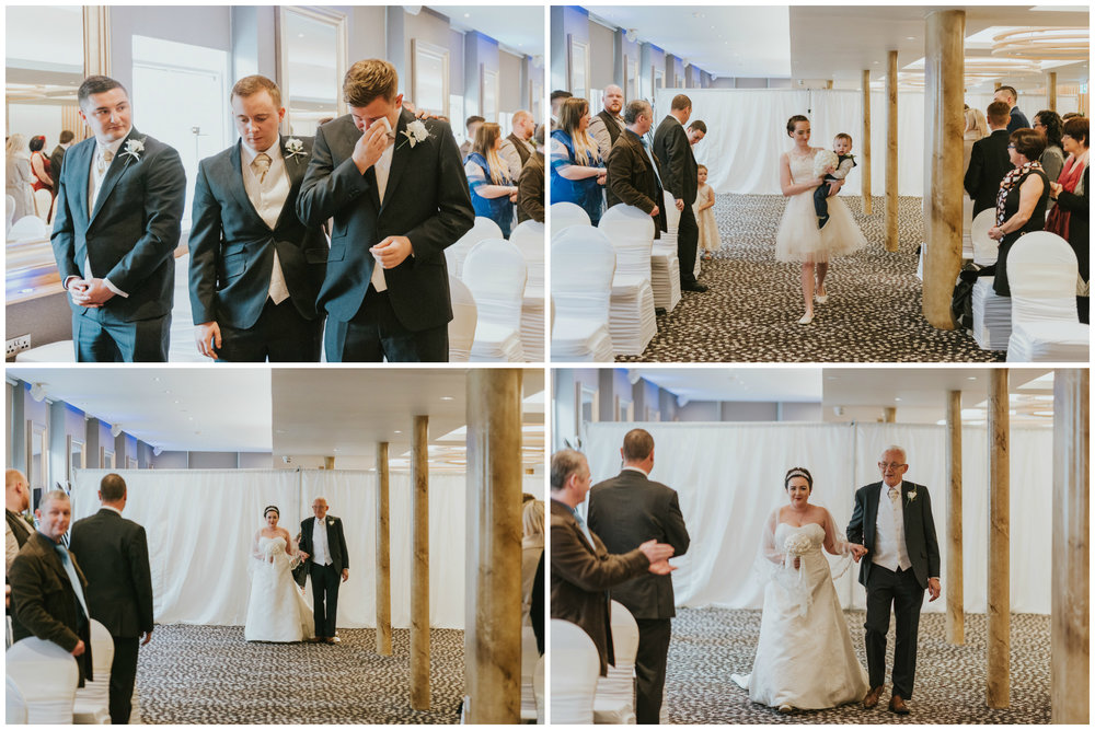 ten square hotel wedding ceremony belfast groom crying bride aisle