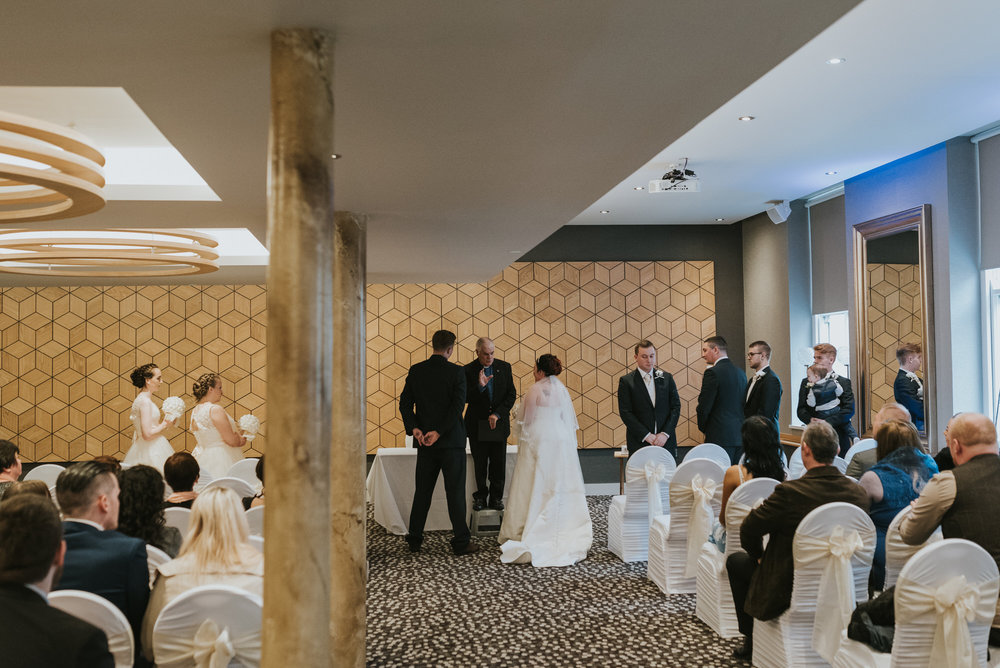 ten square hotel wedding ceremony belfast groom bride together after kiss
