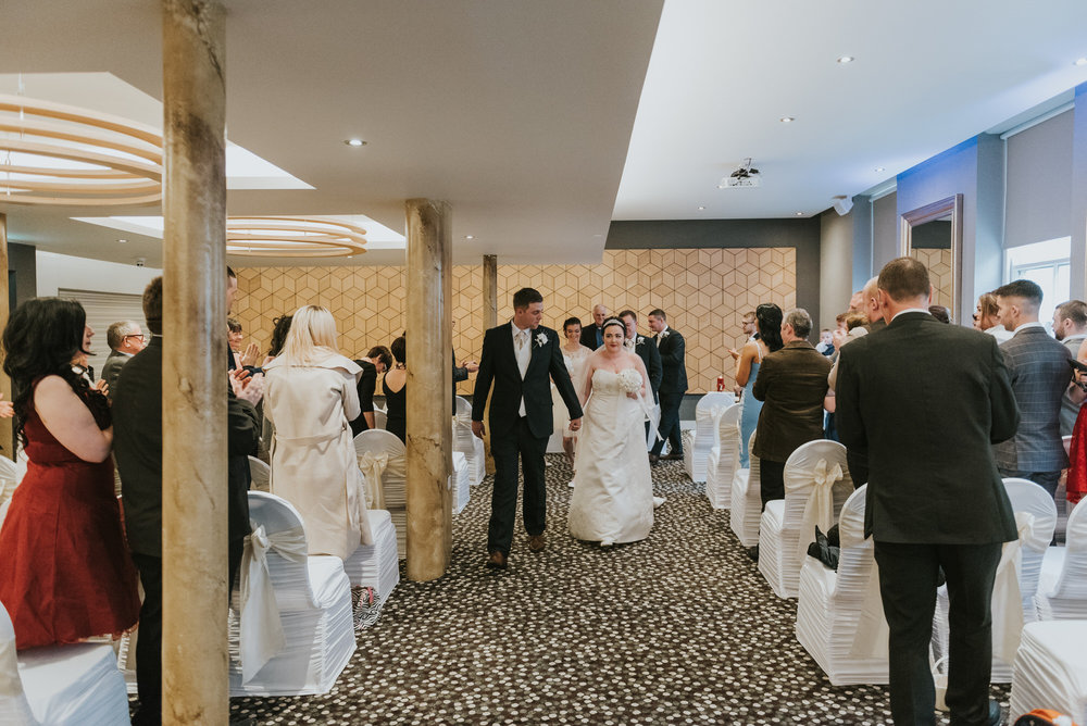 ten square hotel wedding ceremony belfast groom bride aisle