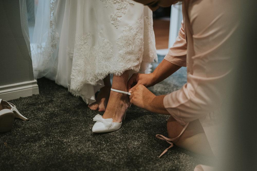 La Mon Hotel wedding bride getting shoes on