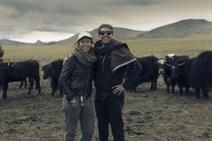 Marc Péridis with Nancy Johnston (Tengri CEO & Founder) wearing    Gaiscíoch Scarf    and standing among a herd of yaks in the Khangai Mountains, western Mongolia.