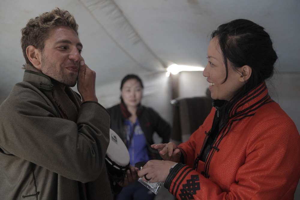 Marc Péridis backstage, preparing with Nancy for the Tengri fashion runway in Mongolia