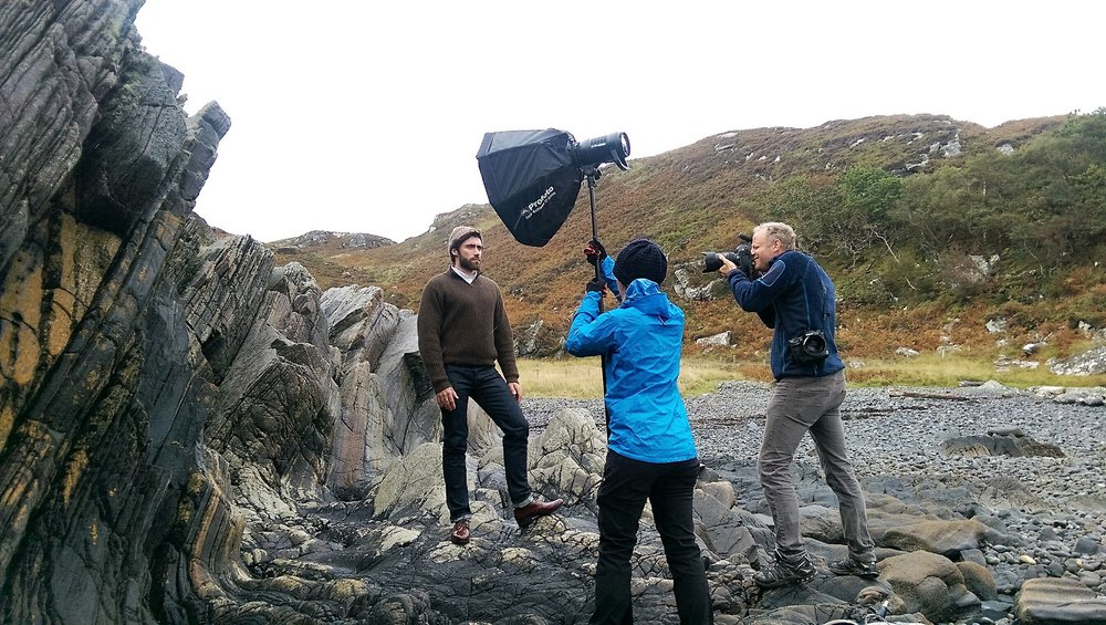 Battling wind and rain, the team with model Kamil Lemieszewski on location in Scotland with expedition photographer, Martin Hartley, for the shoot.